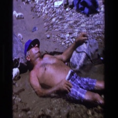 1969: man asleep laying in water. UTAH Stock Footage