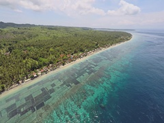 Aerial shot of the coast of Nusa Penida, Bali with colorful shallow coral reef Stock Footage