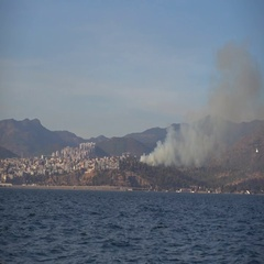 Smoking fire at the far shore of the Gulf of Izmir Stock Footage