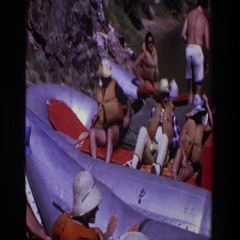 1969: a group of adventurers crowd into a large, inflatable raft UTAH Stock Footage