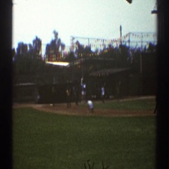 1969: community softball team practicing in a field. WOODLAND HILLS CALIFORNIA Stock Footage