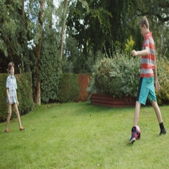 4K 2 Active young boys playing soccer together in the garden Stock Footage