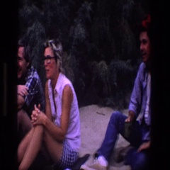 1969: party of people sitting outside enjoying each other's company UTAH Stock Footage