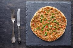 Lahmacun traditional turkish pizza with minced meat, paprika tomatoes, parsley Stock Photos