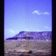 1969: a view of a large mountain ridge as seem from a moving vehicle ARIZONA Stock Footage