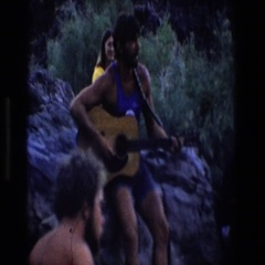 1969: people on the beach listening to a man play guitar UTAH Stock Footage