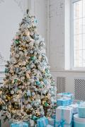 Christmas tree decoration at home interior with blue gift boxes Stock Photos