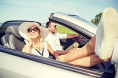 Happy man and woman driving in cabriolet car Kuvituskuvat