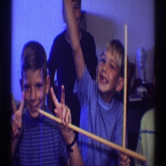 1969: three boys posing in a video with their hands out Stock Footage
