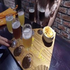 4k crane shot of girl drink craft beer flight Stock Footage