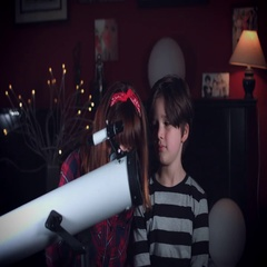 4k Family Home Shot of Child with his Mum Looking through Telescope Stock Footage