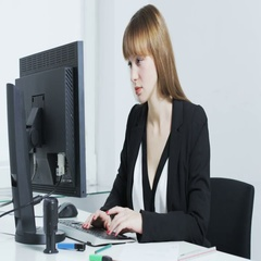 Young woman surprised while looking at a computer Stock Footage
