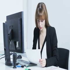 Pretty young woman amused after reading a document Stock Footage