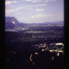 1969: view from above of a grassy terrain and landmarks COLORADO Stock Footage