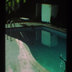 1969: panning camera view of creepy old pool. LOS ANGELES CALIFORNIA Stock Footage
