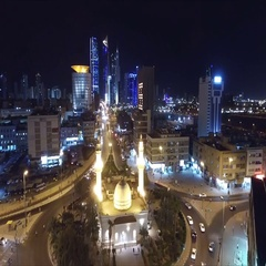 Kuwait skyline at night. Some famous places in Kuwait shooting from the sky Stock Footage