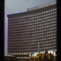 1969: very huge building with so many windows and still in construction. Stock Footage
