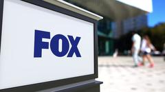 Street signage board with Fox Broadcasting Company logo. Blurred office center Piirros