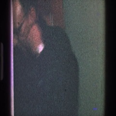 1968: man taking a jacket off by a door TOLEDO OHIO Stock Footage