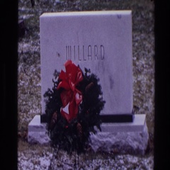 1968: a wreath of flowers sitting in front of a headstone TOLEDO OHIO Stock Footage