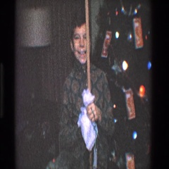 1968: a child is celebrating a special annual event with a family  Stock Footage