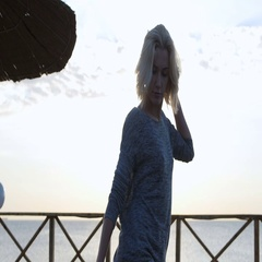 Blond girl in denim shorts dancing happy near the beach at beautuful sunrise Stock Footage