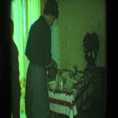 1968: a woman sets the table for supper while her young sons look on TOLEDO OHIO Stock Footage