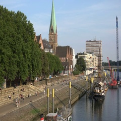 4k People relaxing at sunny river Weser promenade with skyline Bremen Schlachte Stock Footage