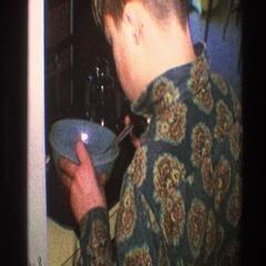 1968: man pouring food into bowl TOLEDO OHIO Stock Footage