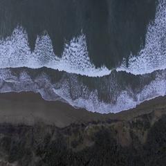 Aerial of waves on seashore at Great Ocean Road Stock Footage