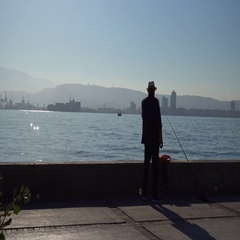 Smoking fisherman at the quay Stock Footage