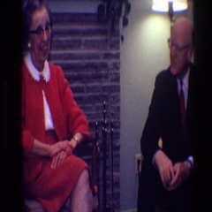 1968: a lady in a red skirt suit is talking to a man in a living room TOLEDO Stock Footage