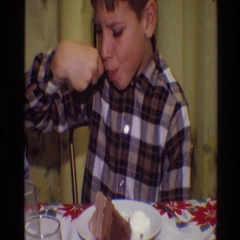 1968: a boy eating cake on top of a white plate with a spoon TOLEDO OHIO Stock Footage