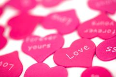 Pink hearts on the white background Stock Photos