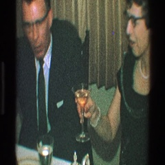 1968: a man and his wife, wine toasts and kisses each other TOLEDO OHIO Stock Footage