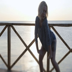Blond girl dancing happy near the beach on the wooden bridge at sunrise Stock Footage