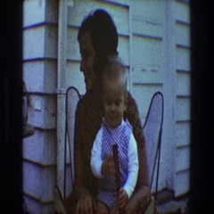 1968: mother holds toddler on lap and cuddles TOLEDO OHIO Stock Footage