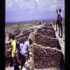 1969: people visiting an interesting stonewall. ARIZONA Stock Footage