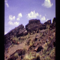 1969: a rock-strewn hill in the wilderness at daytime ARIZONA Stock Footage