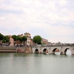 Tiberius bridge and old buildings Rimini Italy Stock Footage