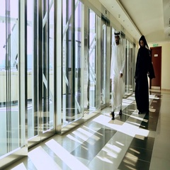 Arab businessman and businesswoman walking in office lobby. Stock Footage