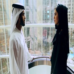 Arab businessman and businesswoman moving up in elevator. Stock Footage