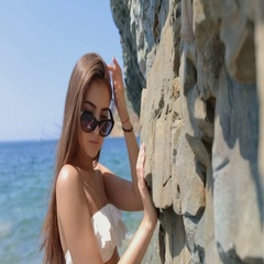 Sensual young woman with long straight hair in sunglasses and white bikini Stock Footage