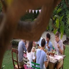 Friends Eat And Drink At Outdoor Party Table Shot On R3D Stock Footage