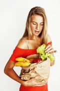 Young pretty blond woman at shopping with food in paper bag isol Stock Photos