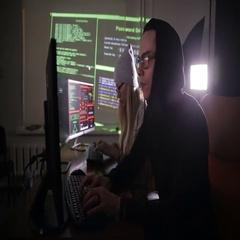 Team of hackers, hacking computers, working in dark room Stock Footage
