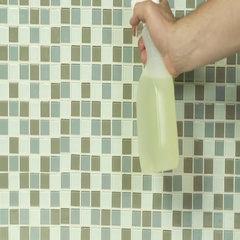 Spray bottle on bathroom tile Stock Footage