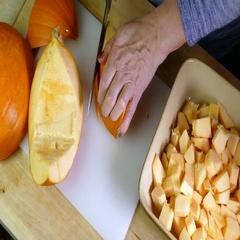 Pumpkin skin being sliced off. Stock Footage