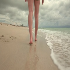 Beautiful woman walking on South beach, Miami, USA Stock Footage