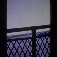 1964: view of an industrial harbor from a bridge out the side of a car  Stock Footage
